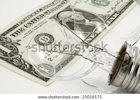 Broken light bulb with money isolated
