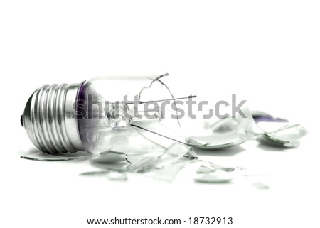 Broken lightbulb isolated on white - stock photo
