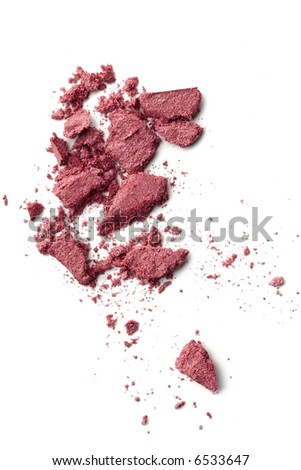 broken makeup particles on white