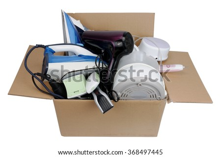 Broken mass production home appliances  in a cardboard box in the service center. Isolated - stock photo