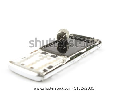 Broken mobile phone over white. Shallow DOF. - stock photo