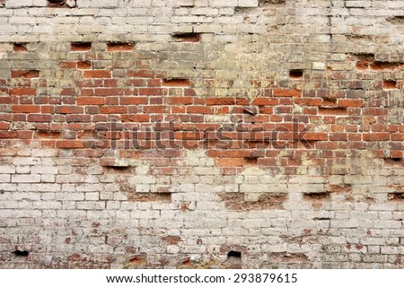 Broken Old Bricklaying Wall Fragment From Red White Bricks And Damaged Plaster Background Texture Close-up - stock photo