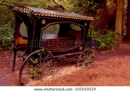 Broken-old coach hearse with the coffin being in the wood . - stock photo
