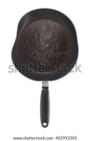 Broken old frying pan isolated on a white background - stock photo