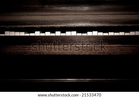Broken old, vintage piano with keys at different positions - stock photo