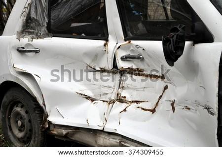 broken old white car door closeup on the street - stock photo