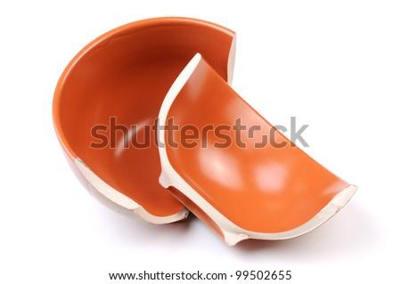 Broken orange plate isolated on white background - stock photo