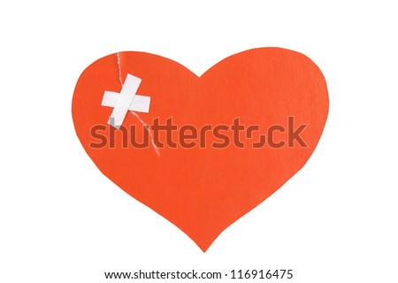 Broken: paper heart torn and fixed with plaster. Isolated on white - stock photo