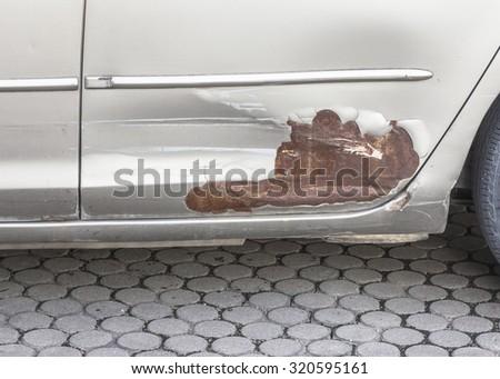 broken part of car body with rusty  on concrete floor - stock photo