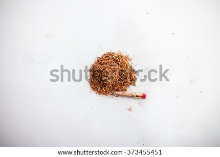 Broken Pencil and Shavings on Dirty White Paper - stock photo