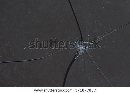 Broken piece of glass abstract background. Shattered fragile material fragments. - stock photo