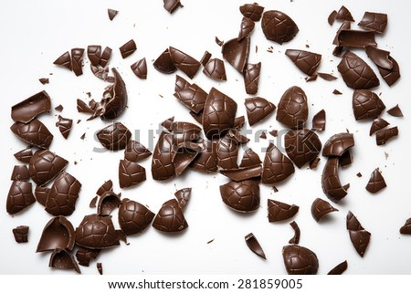 broken pieces of chocolate eggs shot on white background - stock photo