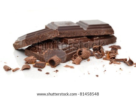 broken pieces of chocolate white background