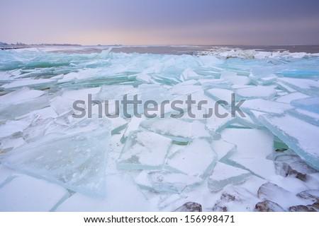 broken pieces of shelf ice on Ijsselmeer in winter, Netherlands - stock photo