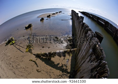 Broken Piers on Biloxi Beach after Hurricane Katrina. Biloxi, Mississippi, United States. - stock photo