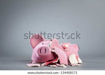 Broken piggy bank. - stock photo