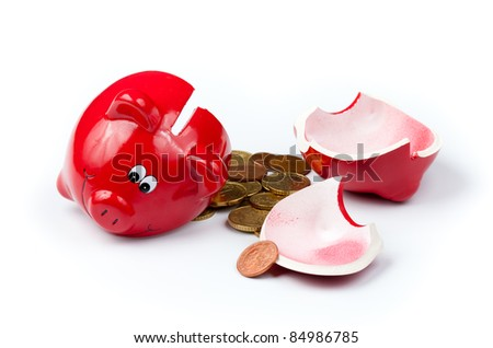 Broken piggy bank or money box with coins isolated on white - stock photo