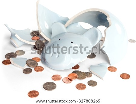 Broken piggy bank with coins scattered - stock photo