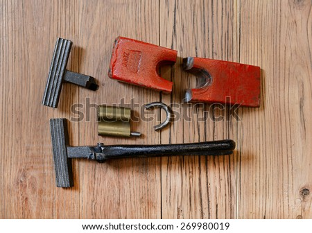 Broken pliers of tightening canvas and the hammer - stock photo