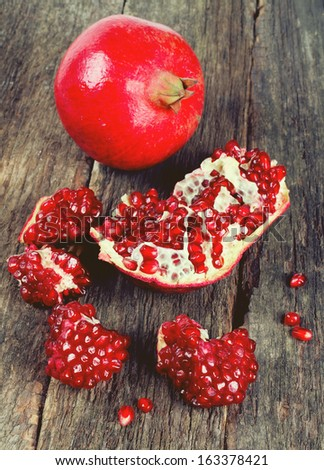 broken pomegranate on wooden surface