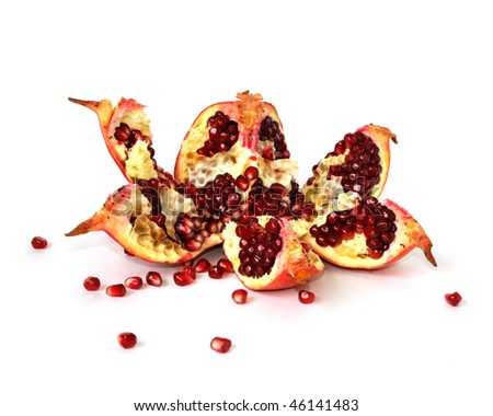 Broken pomegranate with seeds isolated on white background