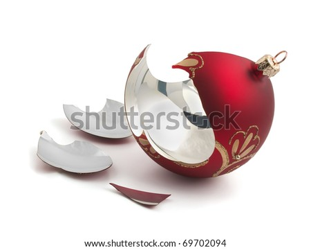 Broken red glass Christmas ball isolated on white - stock photo