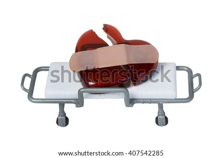 Broken Red glass heart with Bandage on Gurney - path included - stock photo