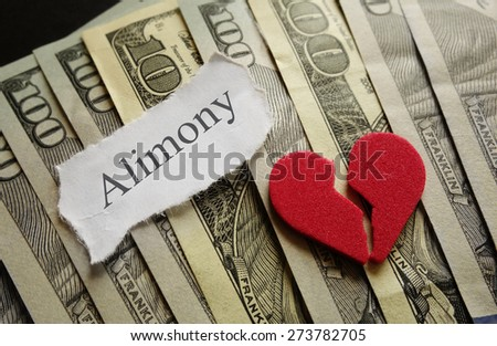 Broken red heart and Alimony paper note on cash                                - stock photo