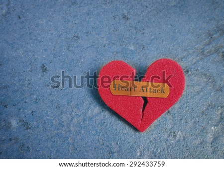 Broken red heart with a bandaid and Heart Attack text                                - stock photo