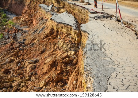 broken road by an earthquake or landslide - stock photo