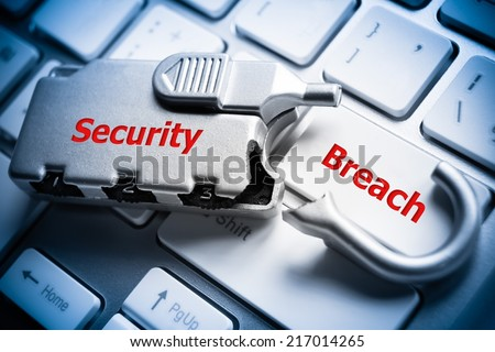 broken security lock on computer keyboard - security breach - stock photo
