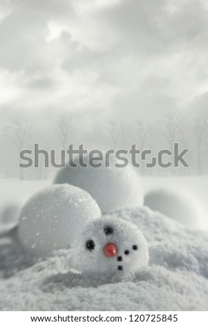 Broken snowman with snowy background - stock photo