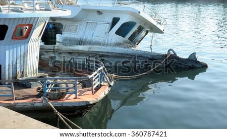 broken sunken pleasure boat in the water, used toning of the photo  - stock photo