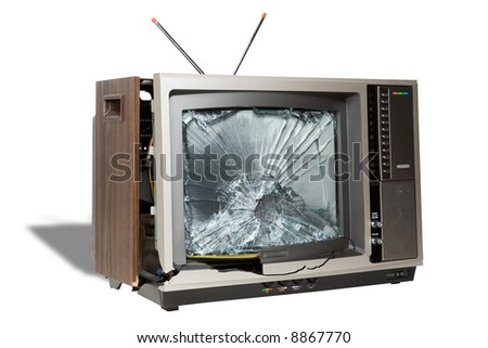 Broken television symbolizing the death of analog television broadcasts in the United States - stock photo