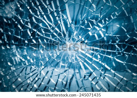 broken toughened glass closeup , background of glass was smashed - stock photo