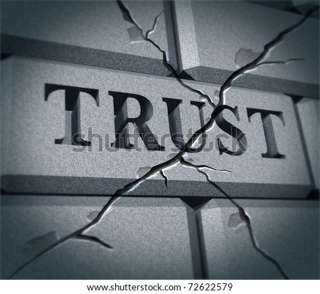 Broken trust symbol represented by a cracked brick wall showing the business metaphor of morality and illegal financial bank and stocks  transactions. - stock photo