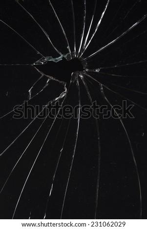 broken vertical glass black background - stock photo