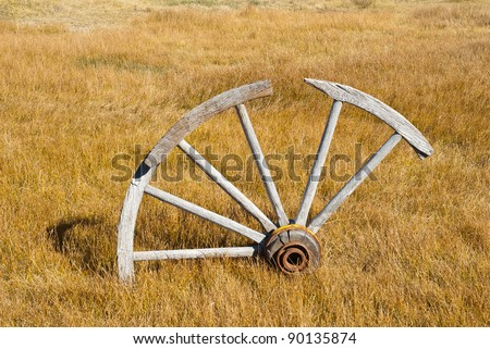 Broken Wagon Wheel at Bodie, a California State Park - stock photo