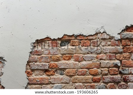 Broken wall with red brick - stock photo