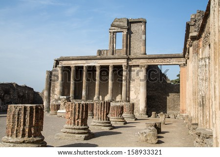 Broken walls and columns in the ancient ruins of Pompeii - stock photo
