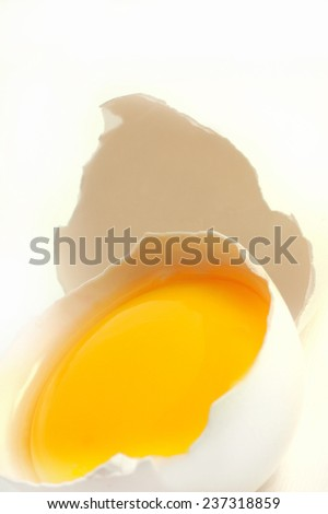 broken white egg over a white background - stock photo
