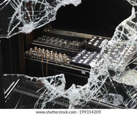 Broken window after jewelry robbery - stock photo