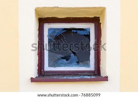 Broken window by angry vandal - stock photo