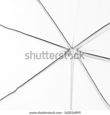 Broken window glass crack splitter on white gray background - stock photo