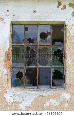 Broken window in a old deserted house - stock photo
