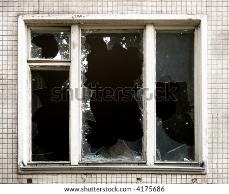 Broken window. Old deserted house. - stock photo