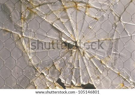 Broken window pane of abandoned factory, East St. Louis, Missouri - stock photo