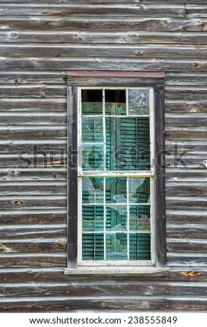 Broken Window Panes in Abandoned Old House - stock photo