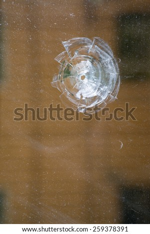 broken window with a bullet hole. - stock photo
