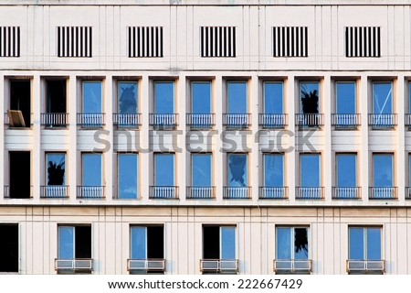Broken windows at building after earthquake destruction  - stock photo